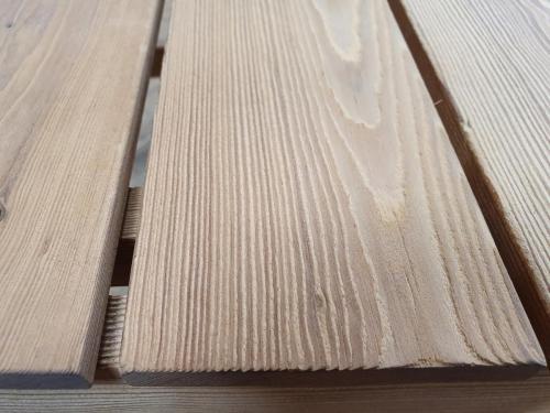Renovation of wood by sandblasting.After